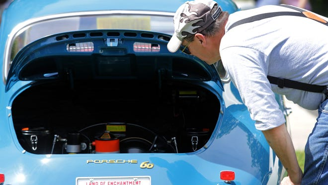 The Appleton Old Car Show and Swap Meet takes place Sunday at Pierce Park in Appleton. Here, Jim Martin of Green Bay takes a look at a 1963 Porsche during last year's event.