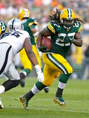 Green Bay Packers running back Eddie Lacy picks up 6 yards in the first quarter against the Oakland Raiders at Lambeau Field.