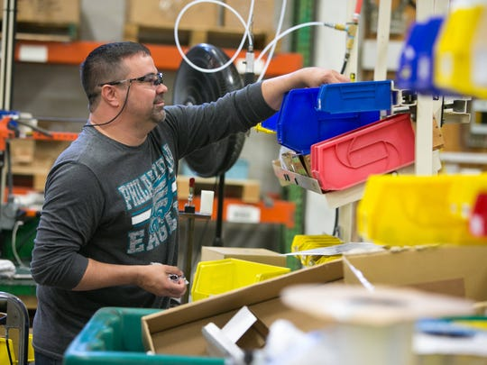 Speakman Co. employee Bobby Tolls works on safety eye washing units at the company's New Castle facility.