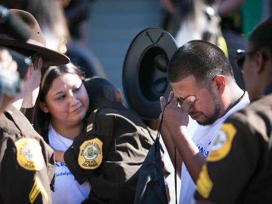 Jose Zamora, father of a terminally ill five-year-old Angel, is in tears after the New Castle County Police, in cooperation with the Make-A-Wish Foundation, fulfilled his son's wish in August by making him a honorary captain for the day.