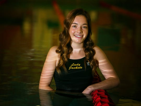 Newark diver, Alexis Bedford, wins her fourth straight state championship.