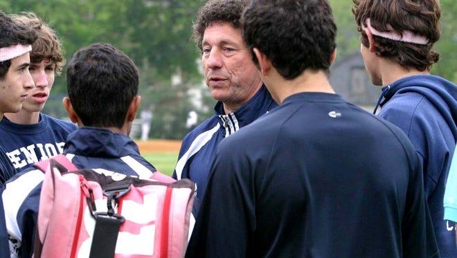 Montclair Kimberley coach Val Azzoli talking to his tennis  team.