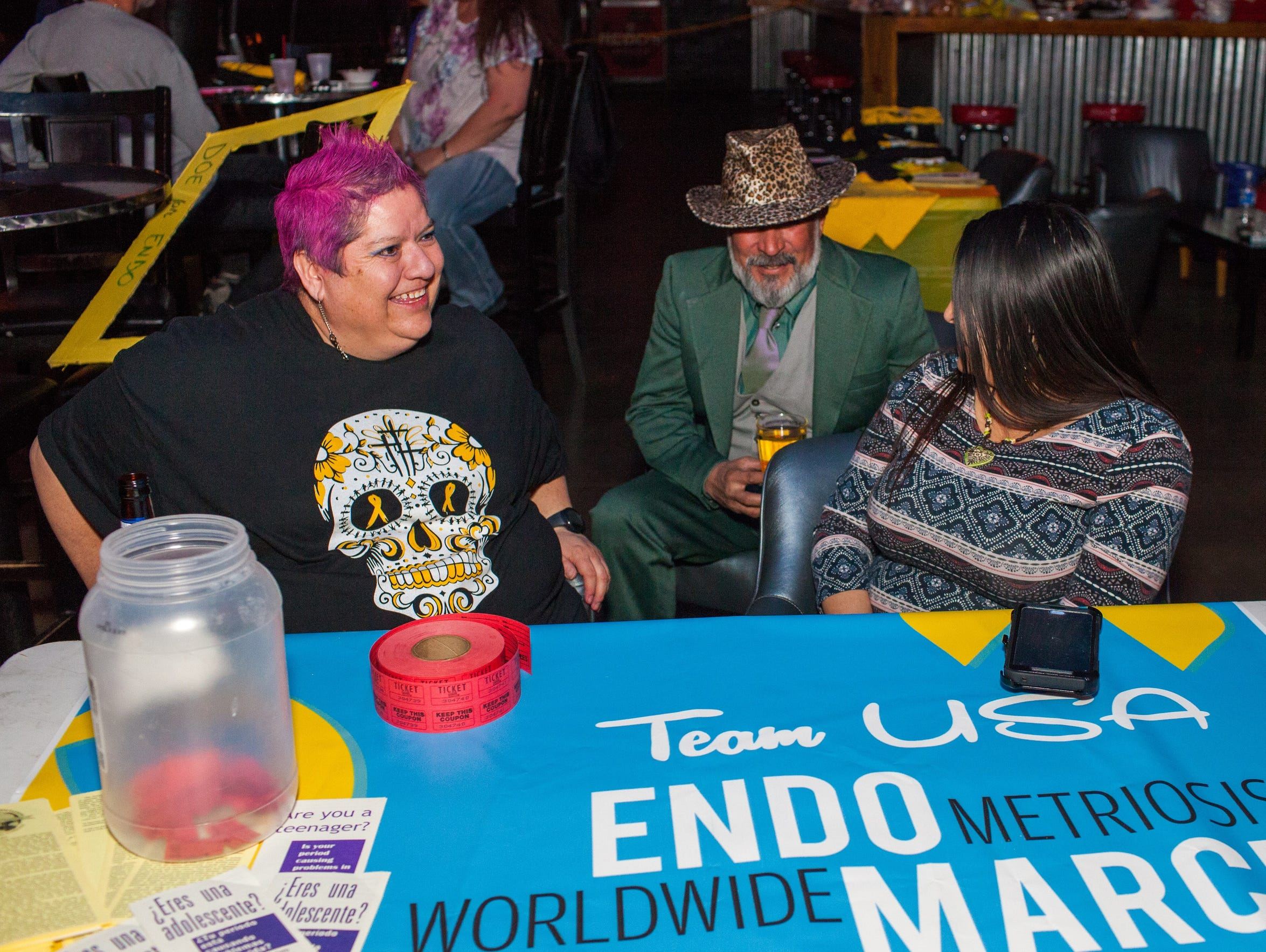 Dolores Gallegos, who was diagnosed with endometriosis 28 years ago, raises funds at The Warehouse Bar so she can attend the Worldwide Endometriosis March in Washington, D.C.
