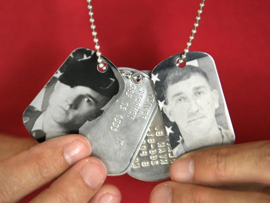 Ryan Weaver wears the dog tags of his brother, Aaron