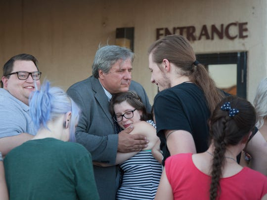 Former Dixie State University theater professor Varlo Davenport celebrates with student well-wishers after he was found not guilty of assaulting a student during a November 2014 acting class Thursday, July 14, 2016.