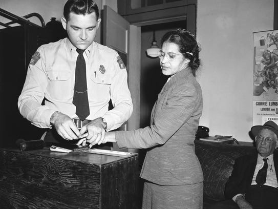 In this  Feb. 22, 1956 photo, Rosa Parks is fingerprinted