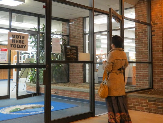 A woman goes to the polls at the Millburn Free Public