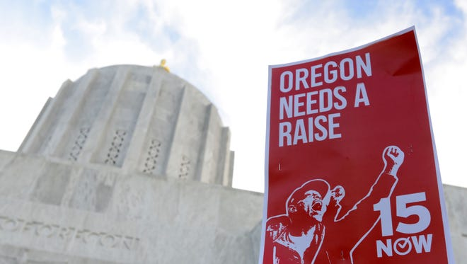 Protestors in support of raising the minimum wage to $15 an hour attend a rally at Oregon State Capitol on Saturday, Jan. 24, 2015, in Salem, Ore.
