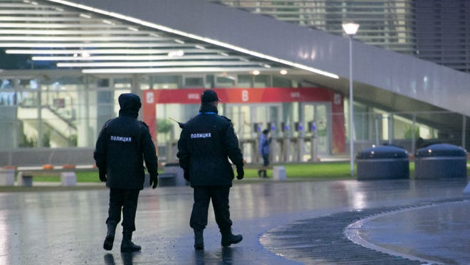 Security guards patrol inside Olympic Park prior to the 2014 Sochi Winter Olympic Games.
