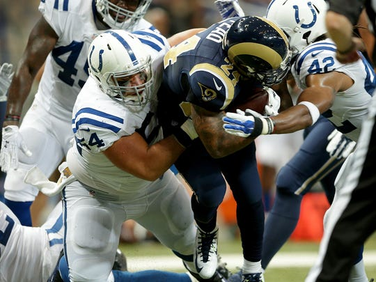 Indianapolis Colts defensive tackle David Parry (54) and safety Clayton Geathers (42) pull down St. Louis Rams running back Isaiah Pead (24) in the second half of their game Saturday, August 29, 2015, at the Edward Jones Dome in St. Louis, MO.