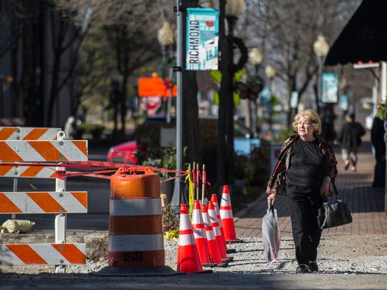 Ronda Christopher crosses Eighth Street in downtown