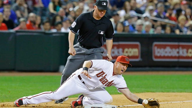 Diamondbacks infielder Cliff Pennington mishandled a ball hit to him at third with one out in the eighth.