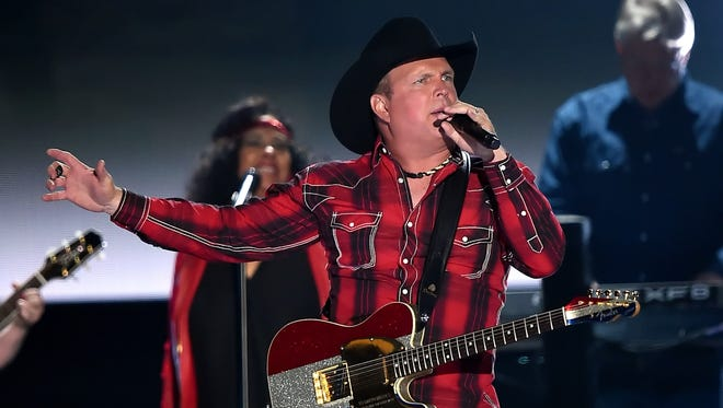 Garth Brooks performs onstage during the 50th Academy Of Country Music Awards at AT&T Stadium on April 19, 2015, in Arlington, Texas.