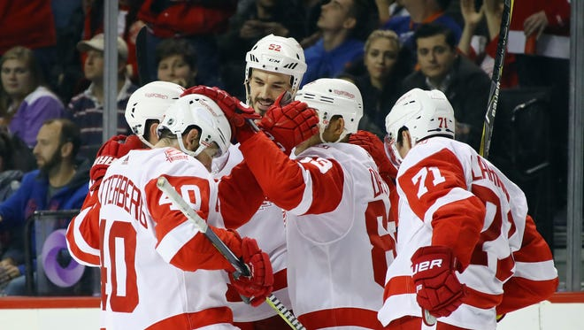 The Red Wings celebrate a goal by Trevor Daley in the third period against the Islanders on Tuesday in Brooklyn, N.Y.
