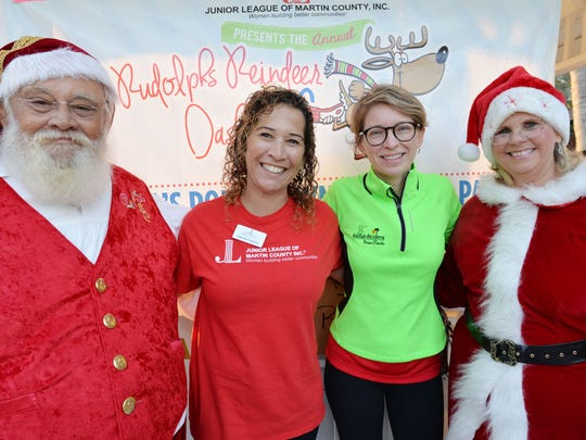 Santa & Mrs. Clause with Event Co-chairs Camille Cannon and Samara Essen