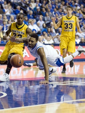 Nov 10, 2013; Lexington, KY, USA; Kentucky Wildcats guard James Young (1) dives for a loose ball against Northern Kentucky Norse guard Todd Johnson (23) and  guard Anthony Monaco (33) in the first half at Rupp Arena. Mandatory Credit: Mark Zerof-USA TODAY Sports
