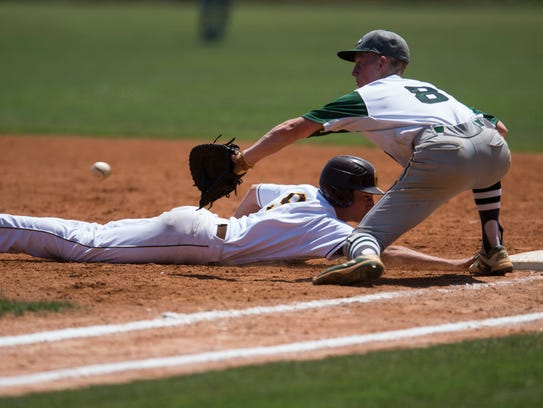 Central's Henry Brown (9) slides safely back into first