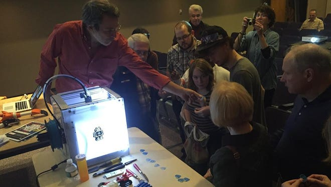 """Jon Schull shows prosthetic hands he made using a 3-D printer at a """"Meet the Inventor"""" event on October 25, 2014."""