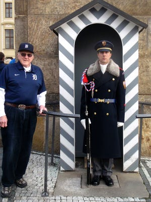 Sharon Alsbro photographs her husband Don Alsbro of Benton Harbor as he stands next to the Guard at the Prague Castle during their trip to Germany and Prague over the Christmas holidays in 2015.