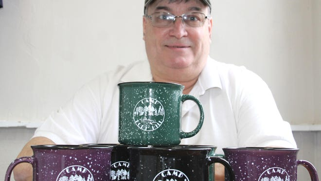 """Dave Ludders, director of Camp Fort Hill, is welcoming the community to """"Coffee at Camp,"""" set for Saturday. Slogan for the event is, """"Grab a Coffee, Take a Hike."""""""