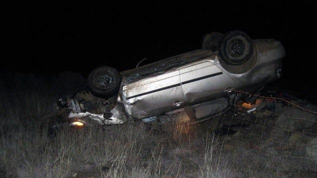 Two people died Wednesday night after rolling over in a 2004 Toyota Corolla.