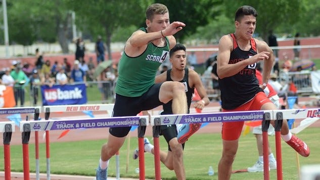 Farmington's Justin Williams competes in the boys 110-meter hurdles preliminary round during Friday's 5A State Track and Field Championships in Albuquerque. Williams advanced to Saturday's final round with a time of 15.08 seconds.