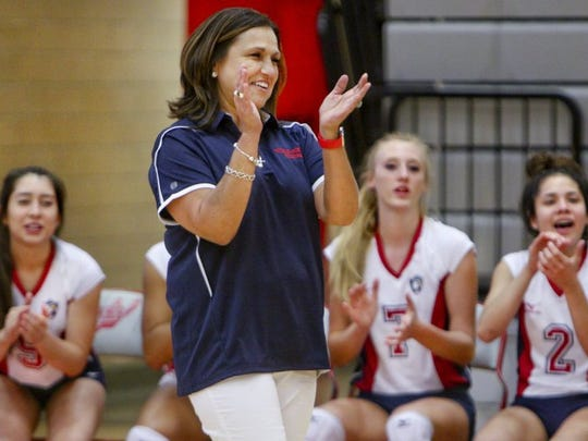 GEORGE TULEY/SPECIAL TO THE CALLER-TIMES Veterans Memorial coach Lupe Cardona applauds another point scored as Alex Morales (5) Olivia Dowden (7) and Brianna Trejo (2) cheer from the bench at Ray High School in Corpus Christi, Monday, August 15, 2016.