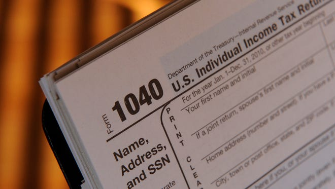 File photo taken in 2011 shows a generic image of the IRS Form 1040 tax return for  income earned in 2010.