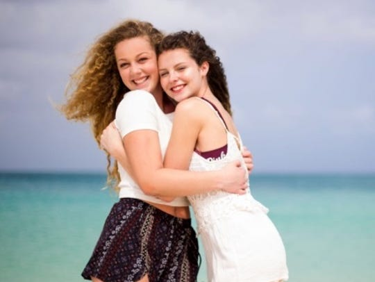Bella Reese, left, with her older sister, Katie Reese,