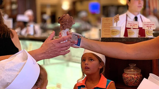 """Adeline Johnson, 6, waits for her treat at Leopold's Ice Cream for saying the """"Pledge of Allegiance"""" in 2019."""
