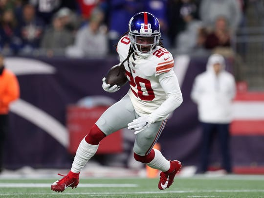 Oct 10, 2019; Foxborough, MA, USA; New York Giants cornerback Janoris Jenkins (20) runs with the ball after intercepting a pass from the New England Patriots during the first half at Gillette Stadium. Mandatory Credit: Paul Rutherford-USA TODAY Sports