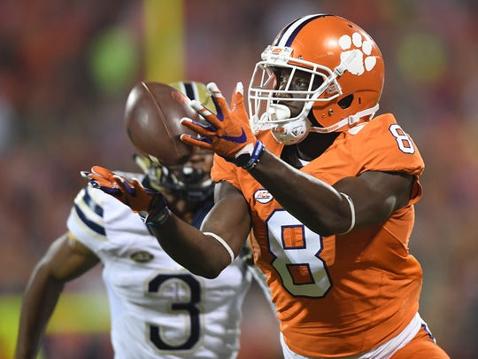 Clemson wide receiver Deon Cain (8) catches a 27 yard