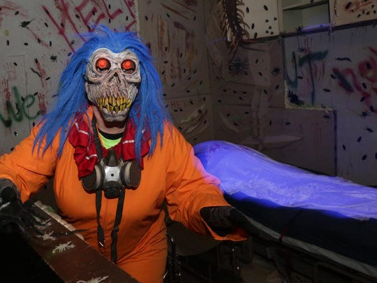 Photos by Dan Young/Daily Herald MediaDisturbing markings on the wall and a scary mask are used to create a frightening scene at last year's Haunted Sawmill in Merrill. Bright colors and and a scary mask are used to create a frightening scene at the Haunted Sawmill in Merrill, Friday, October 18, 2013.