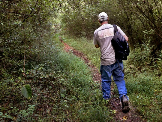 Pat Cummins who is 1/8 Cherokee walks part of the Trail of Tears on Thursday, Sept. 29, 2016. Cummins said he rediscovered the route in 2012, and was surprised that it wasn't underwater after the Percy Priest Lake Project of 1967.