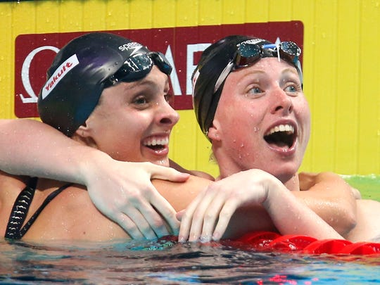 United States' silver medal winner Katie Meili, left, and United States' gold medal winner Lilly King celebrate after the women's 100-meter breaststroke final during the swimming competitions of the World Aquatics Championships in Budapest, Hungary, Tuesday, July 25, 2017.