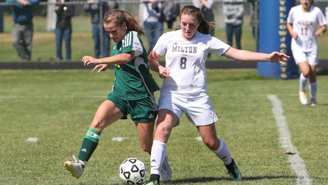 BFA's McKenna Remillard, left, battles with Milton's Kate Rowley in the season opener at Milton. Saturday, 9-2-17.  The Yellowjackets would go on to win 3-1.