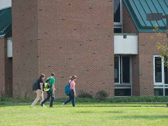 Students out side the Stephen J. Betze Library at the Delaware Technical Community College Owens Campus in Georgetown.