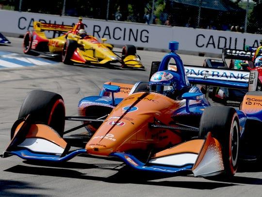 Scott Dixon of Chip Ganassi Racing powers through turn