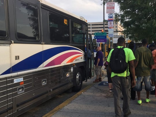 Patrons board an NJ Transit bus at Camden's transportation