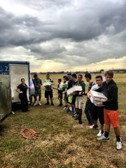 The Palmetto Ridge High School wrestling team helped unload food trucks for Immokalee's Thanksgiving in the Park last Thursday.