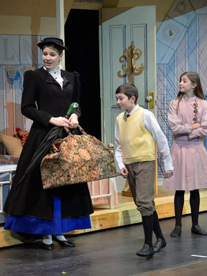 """Mary Poppins (Kayla Parker) settles in with Jane (Aedyn Coville) and Michael Banks (Spencer Lathe) during a dress rehearsal Monday, Jan. 11 for the GREAT Theatre Co. production of """"Mary Poppins"""" at the College of St. Benedict's Benedicta Arts Center."""