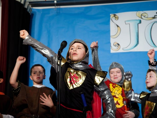 """Prior to the spring recess, Karen Sutherland, music teacher at Woodland School in Warren, directed her students in the musical performance of """"Joust,"""" Some mighty Medieval men from the musical were, from left, Daniel Gerges, Alex Lopez, Sebastian Nunez, Nathan Downey, and Michael Forte. The show combined singing and instrumental music with character education. In the show, King Arthur decided that his knights would carry instruments called boom whackers rather than swords. Following that, France invaded with recorders, and Scotland was armed with bagpipes. The thread of harmony amongst people was evident in many of the numbers, including """"Right Makes Might"""" and """"Peace on Earth."""""""