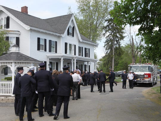 Mourners wait on line outside McHoul Funeral Home during the wake of fallen Fireman Timothy Gunther in Hopewell Junction on Saturday.