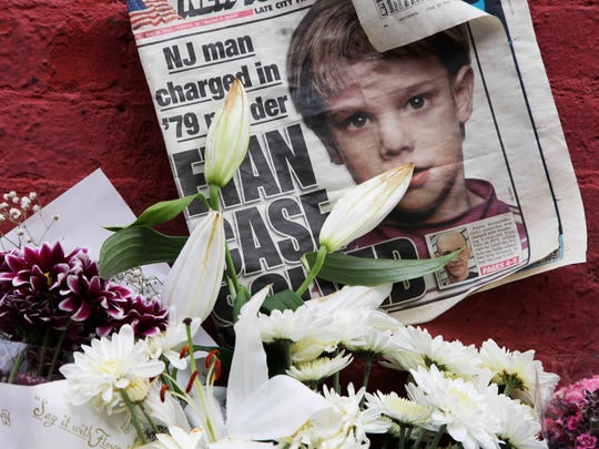 A 2012 file photo shows a newspaper with a photograph of Etan Patz at a makeshift memorial in the SoHo neighborhood of New York where Patz lived before his disappearance on May 25, 1979.