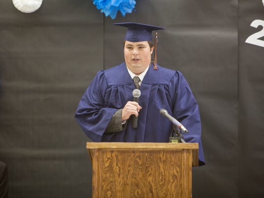 Danny Jessop becomes the first graduate of Water Canyon High School in Hildale on Wednesday.