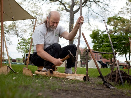 James Snellenberger, of East Lansing, uses a tomahawk to makes stakes in preparation for the 35th annual Feast of the Ste. Claire Thursday at Pine Grove Park in Port Huron. More than 550 re-enactors will be at the event, which runs Saturday through Sunday.