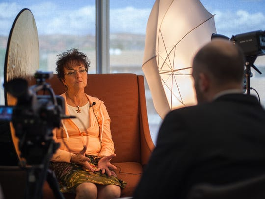 Southern Utah resident Terry Bell speaks to North Carolina Central University law student Mark Wampler about her experiences growing up near a Nevada military installation during filming of a documentary on Downwinders in this April 1, 2014 file photo.