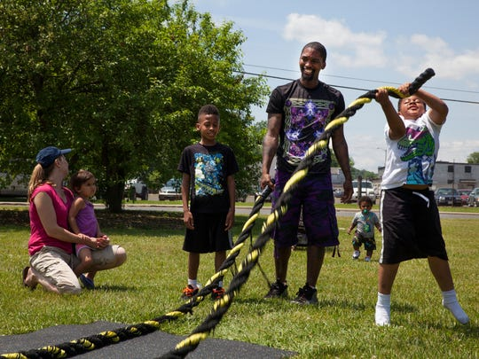 George Osborne and his two sons, Maurice Osborne, left, and Milano Osborne participate in a high-intensity interval training course run by Shenandoah Powerhouse Gym at XtremeFest.