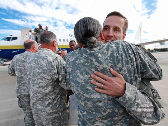 2009: Then-Attorney General Beau Biden is greeted by