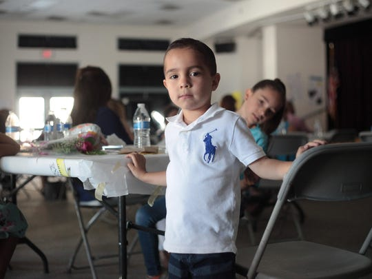 Aiden Flores, 4, watches his fourth grade sister's short film at Amelia Earhart Elementary School in La Quinta on June 5.